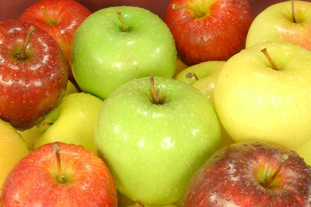 Different Sorts Apples. Different sorts apples covered with water drops on market fro sell. Stock Photo - 2672603