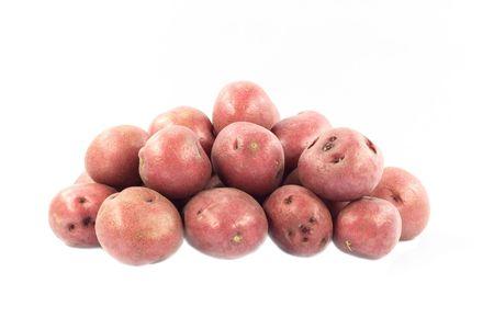 Red mini potatoes over white background.