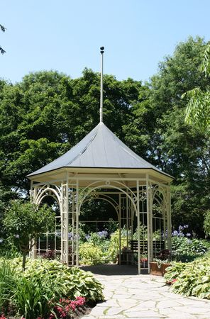 architectural style: Summerhouse in Shakespeare Garden in Stratford Ontario. Old architectural style metal Gazebo in Startford, Ontario, Canada - Shakespeare Garden.