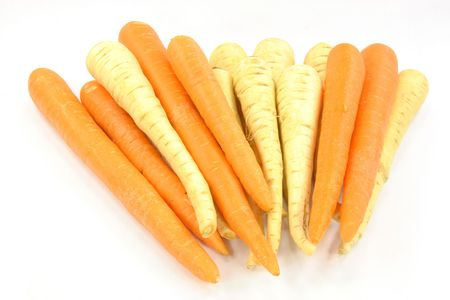belongs: Parsnips and carrots roots. Group of white roots - parsnips and carrot. Parsnip belongs to carrot . Stock Photo
