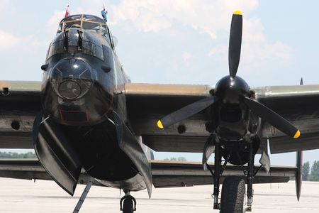 Avro Lancaster bomber. Front wiev. Front view of the Lancaster Bomber - cockpit, open bomb bay, One of four engine Rolls Royce Merlin, Nose autamatic weapons,  photo