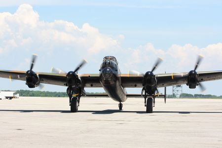 W.W.II legendary aircraft bomber. The most sophisticated British Bomber Lancaster with running engines ready to go to the start line. photo