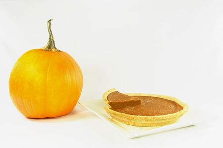 pumpkin pie: Picture representing frozen pumpkin pie and pumpkin ready to be cooked as pie.  Stock Photo