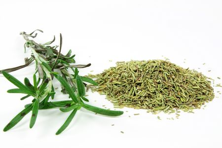 Picture of pile dried and stalks fresh Rosemary used for seasoning when cooked meat.