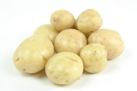 Pile fresh mini white potatoes - still life picture.  Stock Photo