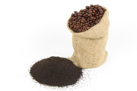 Coffee grounds. Picture displaying spilled final product after grinding of coffee beans used for preparing Espresso and starting product roasted coffee beans in burlap sack over white background.