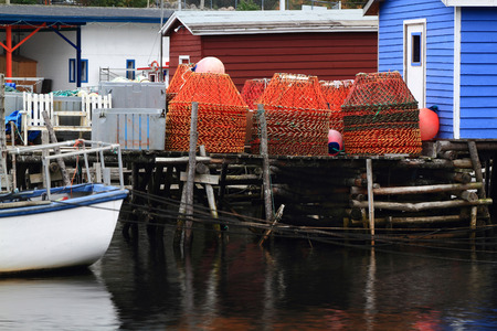 stocked: Dock for crab fishermen with stocked on pile Crab Nets in Petty Harbor, Newfoundland, Canada   Stock Photo