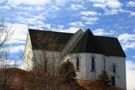 17th: Old Anglican architectural Style Church first built in middle of 17th Century and modernized lately on  The Walk  road of Brigus Cove on the end of Conception  Brigus  Bay Newfoundland, Canada