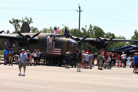 liberator:  HAMILTON, ONTARIO CANADA - JUNE 15, 2014  One of two flying in world The B-24 Liberator  Diamond Lil  on display takes attraction of the visitors on Father s Day FlyFest