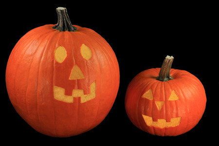 hallows: Decoration Symbols of Halloween Holiday known as All Hallows Evening Carved Pumpkins with goblin or hobgoblin faces known as Jack-O-Lantern  over black background