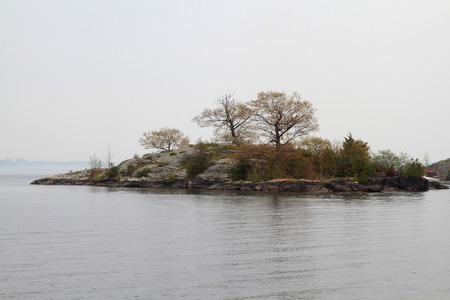 kingston: One of the Thousand Islands in Kingston Ontario St. Lawrence River area in Foggy Day Stock Photo