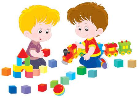 preescolar: Los niños pequeños juegan con un tren de juguete y ladrillos