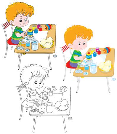 eastertide: Boy paints Easter eggs