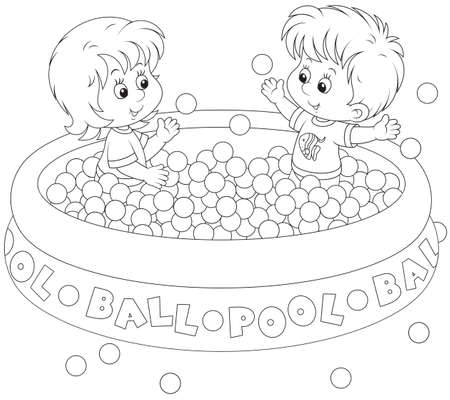 child of school age: Little girl and boy playing in a ball pool