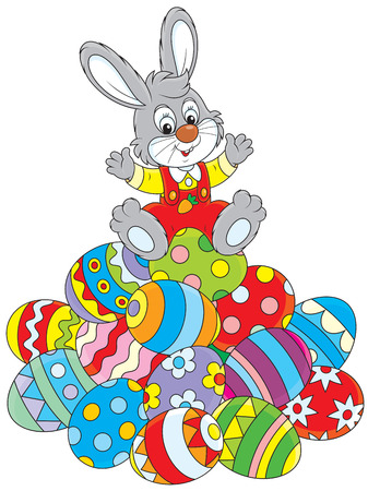 festal: Little rabbit sitting on a pile of Easter eggs