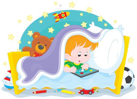 sleeping car: boy plays on a tablet computer under a blanket