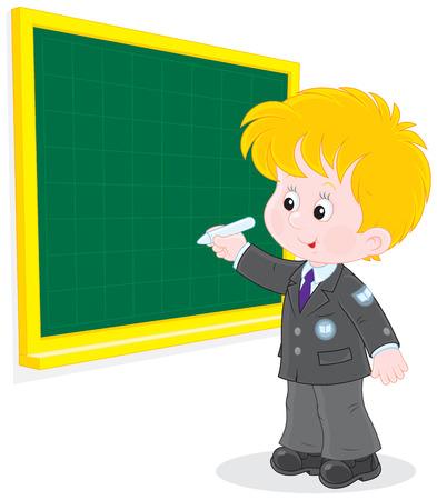 schooldays: Schoolboy writes on the blackboard with chalk