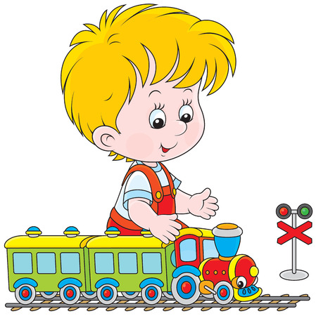 playschool: Little boy playing with a small toy train