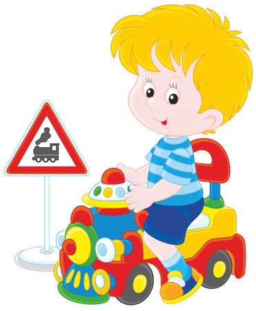 baby playing toy: Little Boy playing with a big toy train
