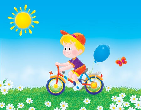 lad: boy cycling on the grass in summer day