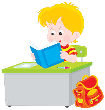 child of school age: Schoolboy reading a textbook