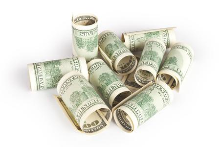 money pile: pile of money isolated on white Stock Photo