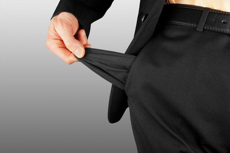 empty pockets: bankrupt business man showing empty pocket  hand