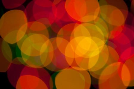luminous: abstract background - defocused luminous colored objects on a black backgrounds
