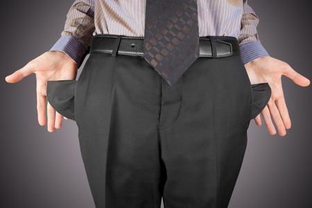 empty pockets: bankrupt business man showing empty pockets  hands