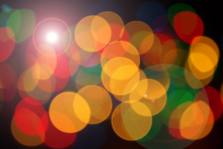 brightly colored: abstract backgrounds - defocused luminous colored objects on a black background