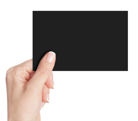 Womens fingers holding a black  business card isolated on white background