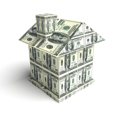 House from the money isolated on white. Business concept Stock Photo
