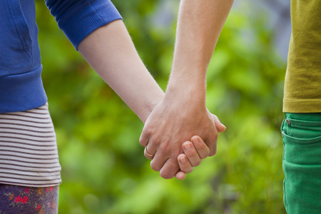 hand care: Loving couple holding hands of each other on nature