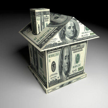 oncept: House from the money. Business and construction oncept