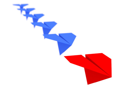 leading the way: Leadership concept. One red leader plane leads other blue planes forward Stock Photo