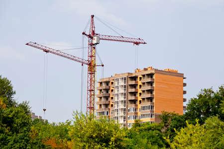 new building: Crane building a new multi-storey building. Construction concepts