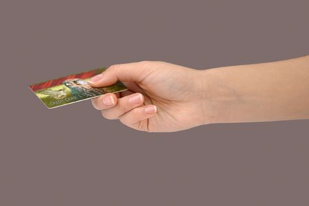 Female hand holding a general credit card Stock Photo - 333600