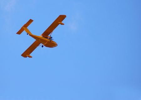 hydroplane: Flying hydroplane on blue sky background