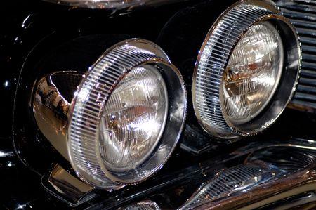Old vintage black car headlight photo