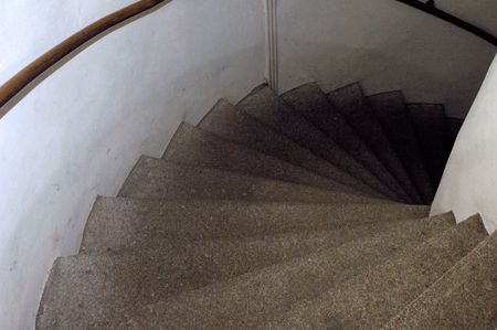 Spiral ancient stone stairs photo