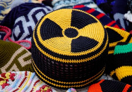 Nuclear energy radiation hazard yellow black symbol pattern on knitted fabric cap Stock Photo - 399465