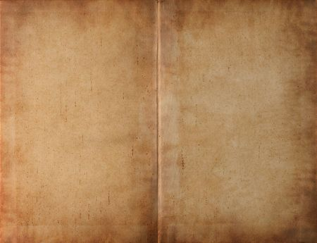 Unfolded old ancient book cover - smudged parchment paper texture background photo