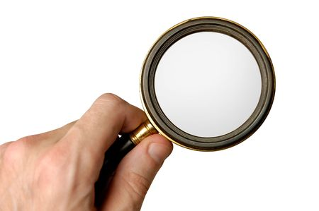 Big magnifying glass in hand isolated on white background with clipping path photo