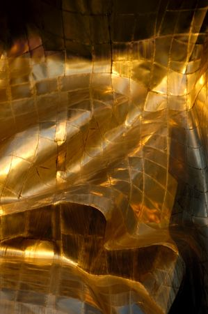 titanium: Abstract gold metal patches background texture Stock Photo