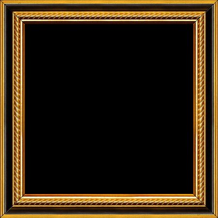 Antique wooden frame with guilded pattern Stock Photo