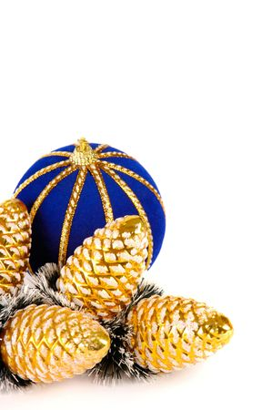 Blue ball and golden cones Christmas tree decoration isolated on white photo
