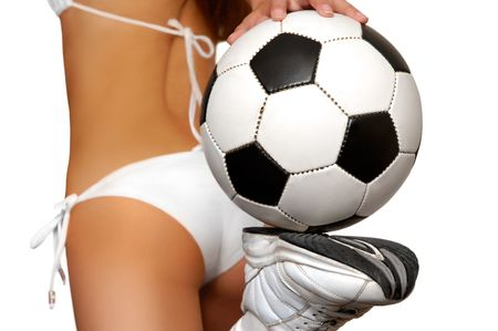 Girl in bikini with soccer ball isolated with clipping path on white photo