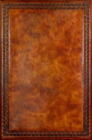 scrapbook cover: Brown leather book cover with decorative pattern