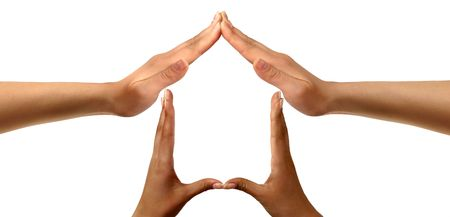 Conceptual symbold home made from black and white hands isolated over white background Stock Photo