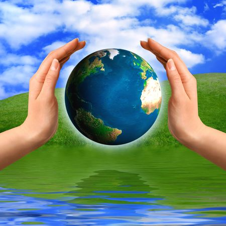 energy healing: Earth globe in hands Environment and ecology concept